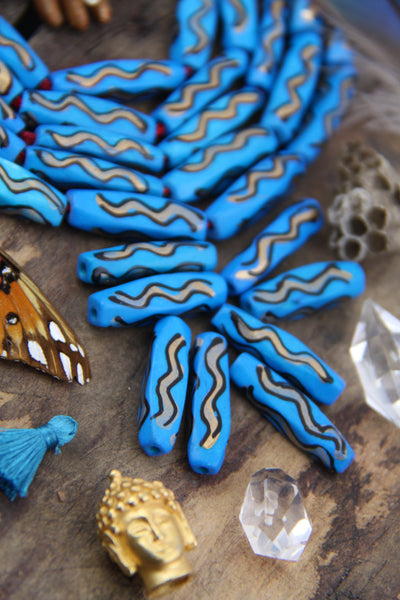 Blue Squiggle Barrel: Hand Painted Bone Beads, 7x27mm, 8 pieces - ShopWomanShopsWorld.com. Bone Beads, Tassels, Pom Poms, African Beads.