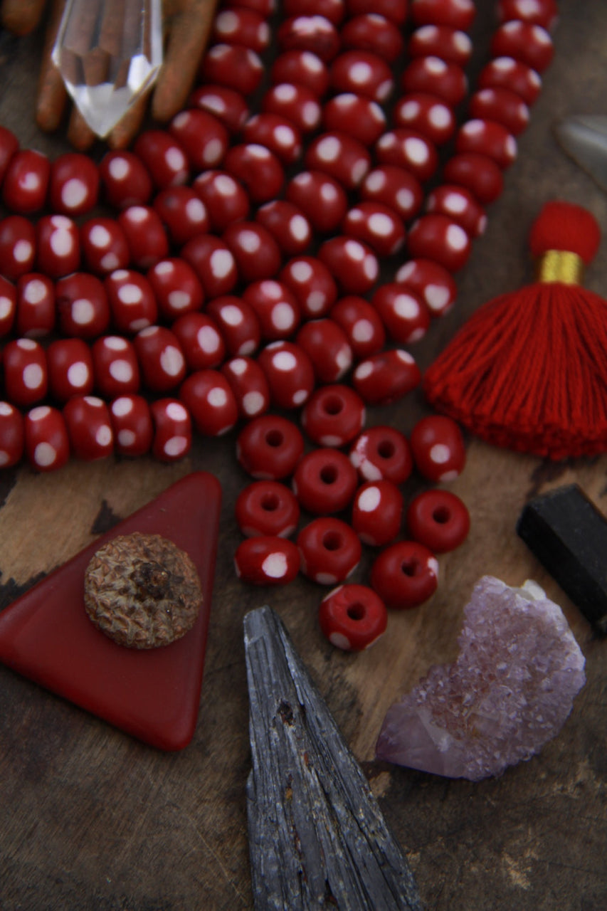 Burgundy Ladybug: Polka Dotted Maroon Bone Beads, 6x8mm, 30 pieces - ShopWomanShopsWorld.com. Bone Beads, Tassels, Pom Poms, African Beads.