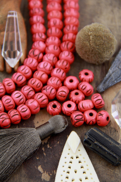 Grooved Salmon Tribal Loops: Carved Bone Beads, 9x7mm, 30 pieces - ShopWomanShopsWorld.com. Bone Beads, Tassels, Pom Poms, African Beads.