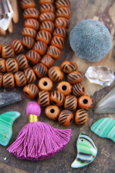 Grooved Salmon Chestnut: Hand Carved Bone Beads, 10x8mm, 27 pieces - ShopWomanShopsWorld.com. Bone Beads, Tassels, Pom Poms, African Beads.