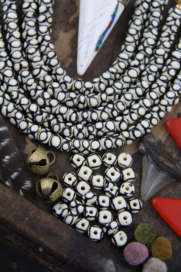 White & Black Infinity Circles: Handmade Bone Beads, 8x6mm, 30 Pieces - ShopWomanShopsWorld.com. Bone Beads, Tassels, Pom Poms, African Beads.
