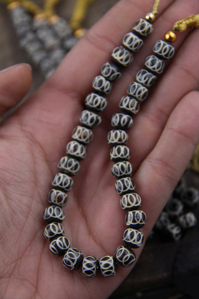 Loopde Loop: Brown & White Bone Beads, 8x7mm, 30 pieces - ShopWomanShopsWorld.com. Bone Beads, Tassels, Pom Poms, African Beads.