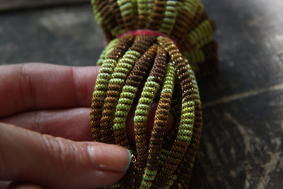 Ombre Olive & Brown Webbed Nylon Cord, Ribbon, Trim, 4mm x 16 yards - ShopWomanShopsWorld.com. Bone Beads, Tassels, Pom Poms, African Beads.
