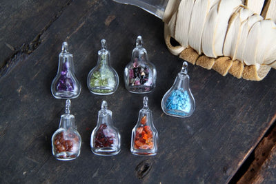 Choose Your Magic: Tiny Glass Bottle Pendant, Charm with Gemstone Chips - ShopWomanShopsWorld.com. Bone Beads, Tassels, Pom Poms, African Beads.