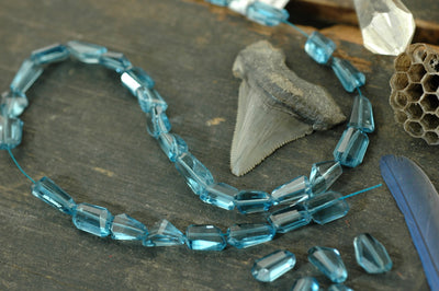Blue Ice: London Blue Topaz Faceted Nugget Beads,1 bead, 6x10mm - ShopWomanShopsWorld.com. Bone Beads, Tassels, Pom Poms, African Beads.