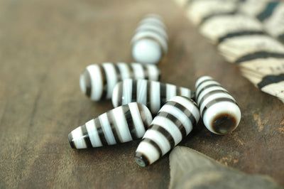Striped Tears: 10x23mm Black and White Teardrop Pendant, 1 piece - ShopWomanShopsWorld.com. Bone Beads, Tassels, Pom Poms, African Beads.