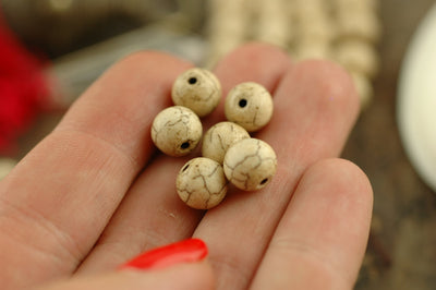 Sand and Sea: Natural Antiqued Nepali Shell Round Beads 8mm / 10 Loose beads / Nautical Boho Yoga Fashion, Jewelry Making Supplies / Tan - ShopWomanShopsWorld.com. Bone Beads, Tassels, Pom Poms, African Beads.