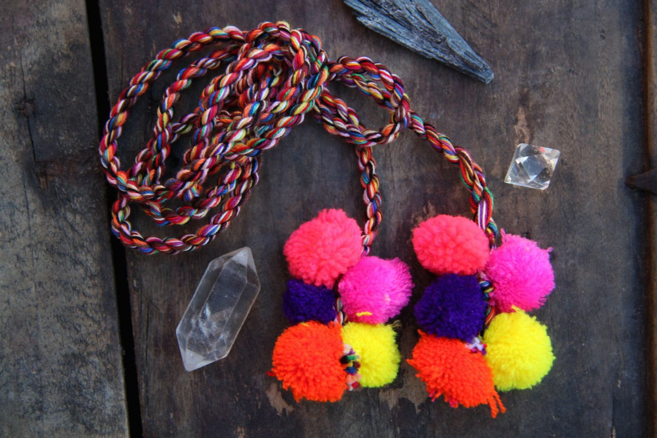 Pom Pom Camel Swag, Neon Multi-Colored Poms - ShopWomanShopsWorld.com. Bone Beads, Tassels, Pom Poms, African Beads.