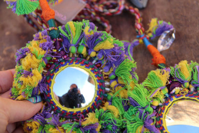 Large Camel Swag: Purple, Yellow, Green Mirrored Pom Charm - ShopWomanShopsWorld.com. Bone Beads, Tassels, Pom Poms, African Beads.
