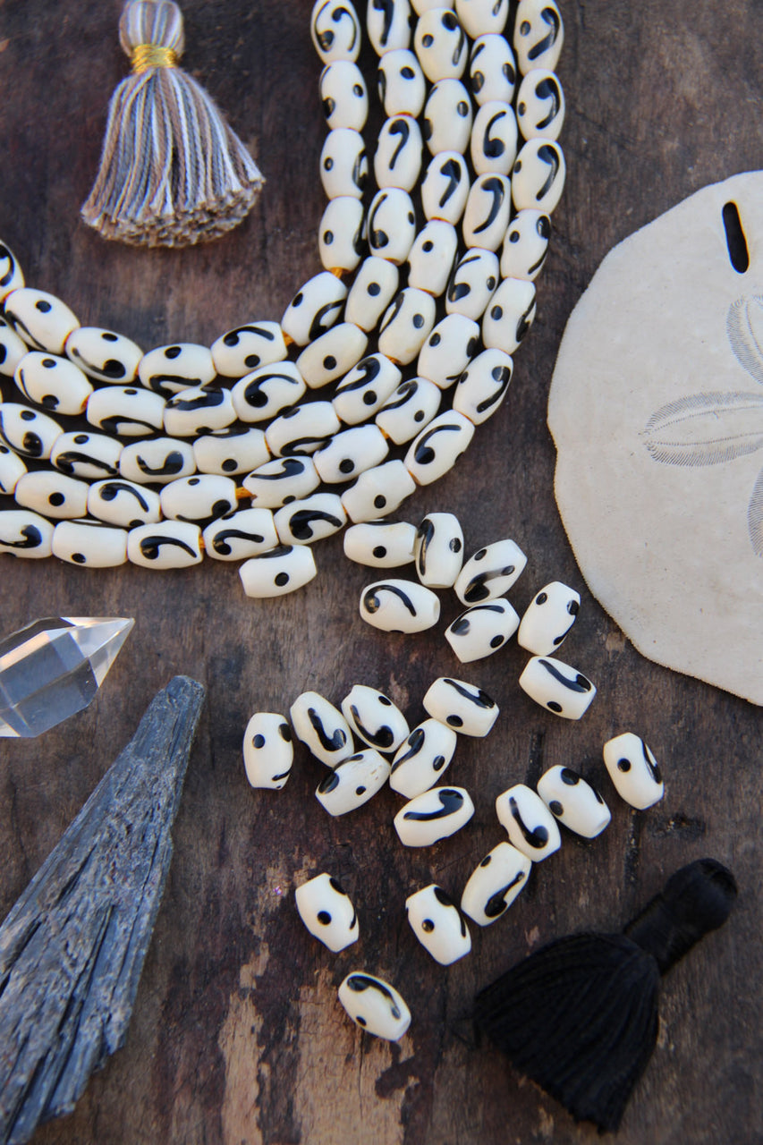 Comma Barrel: Black & White Hand Painted Bone Beads, 6x8mm, 22 pieces - ShopWomanShopsWorld.com. Bone Beads, Tassels, Pom Poms, African Beads.