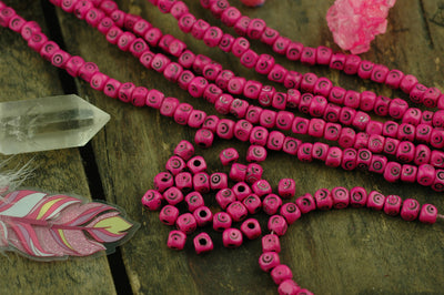 Fuschia Tumbling Dice: Hand Carved Bone Beads, 5x5mm, 48 pieces - ShopWomanShopsWorld.com. Bone Beads, Tassels, Pom Poms, African Beads.