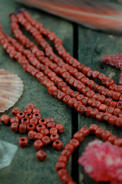 Brick Red Tumbling Dice: Hand Carved Bone Beads, 5x5mm, 48 pieces - ShopWomanShopsWorld.com. Bone Beads, Tassels, Pom Poms, African Beads.
