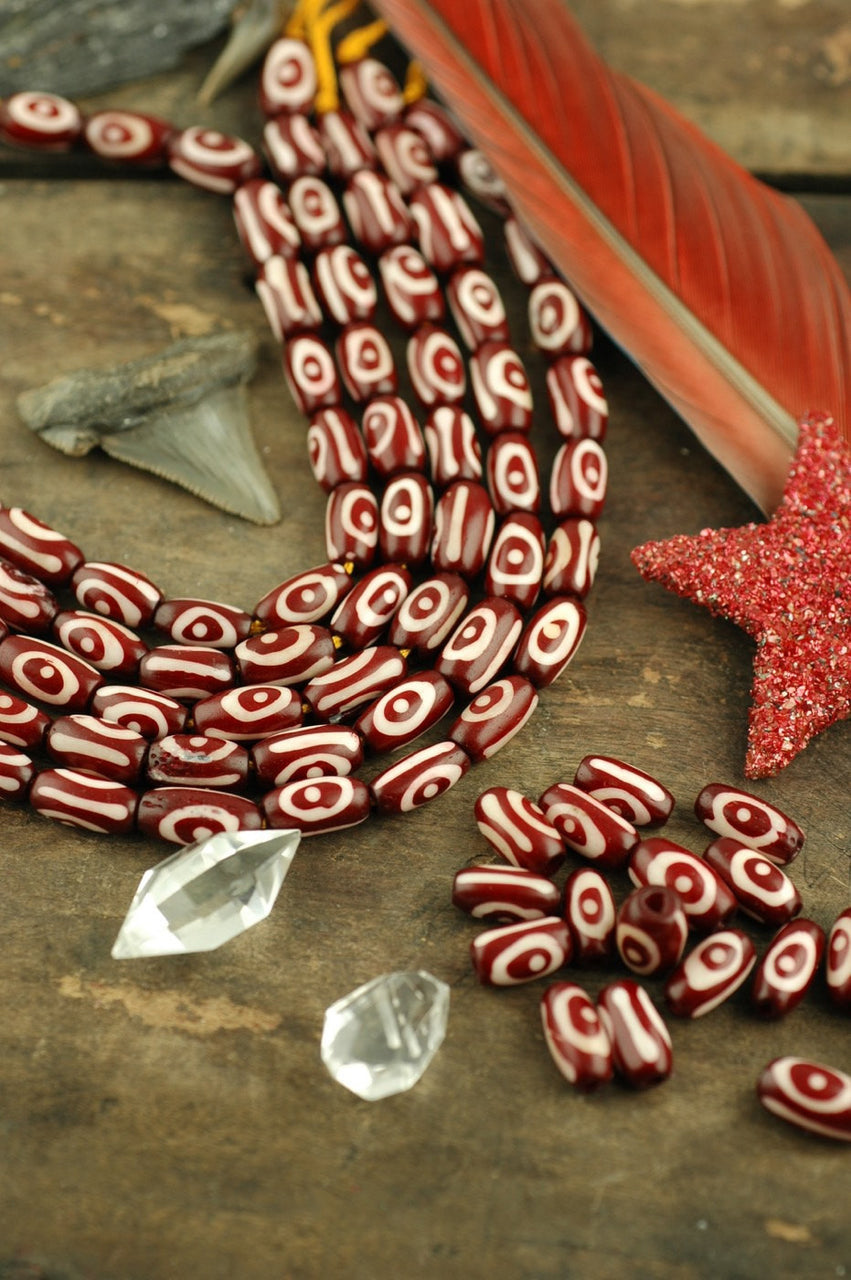 Maroon Barrel: Spiral Design Bone Beads, 7x13mm, 16 pieces - ShopWomanShopsWorld.com. Bone Beads, Tassels, Pom Poms, African Beads.
