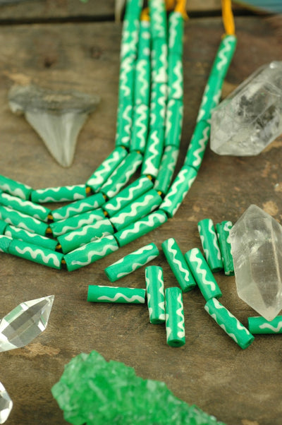 Green Wavy Tube: Handmade Bone Beads, 4x19mm, 11 pieces - ShopWomanShopsWorld.com. Bone Beads, Tassels, Pom Poms, African Beads.