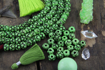 Lime Loops: Green Hand Carved Bone Beads, 8x11mm, 22 pieces - ShopWomanShopsWorld.com. Bone Beads, Tassels, Pom Poms, African Beads.