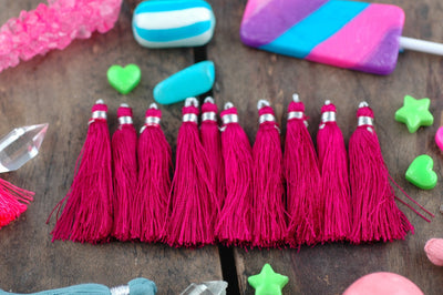 "Tassel Ten Pack, Fuchsia Pink, 2"" Art Silk from India - ShopWomanShopsWorld.com. Bone Beads, Tassels, Pom Poms, African Beads."