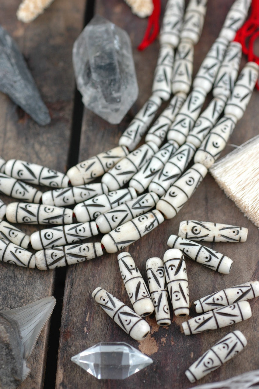 Natural Cream Teardrop: Hand Carved Bone Beads, 7x24mm, 8 pieces - ShopWomanShopsWorld.com. Bone Beads, Tassels, Pom Poms, African Beads.