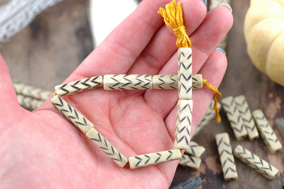 Pastel Yellow Chevron Rectangle: Hand Painted Bone Beads, 6.5x28mm, 8 pieces - ShopWomanShopsWorld.com. Bone Beads, Tassels, Pom Poms, African Beads.