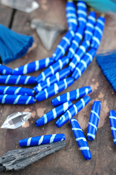 Diagonal Striped Tube: Royal Blue Bone Beads, 8x35mm, 6 pieces - ShopWomanShopsWorld.com. Bone Beads, Tassels, Pom Poms, African Beads.