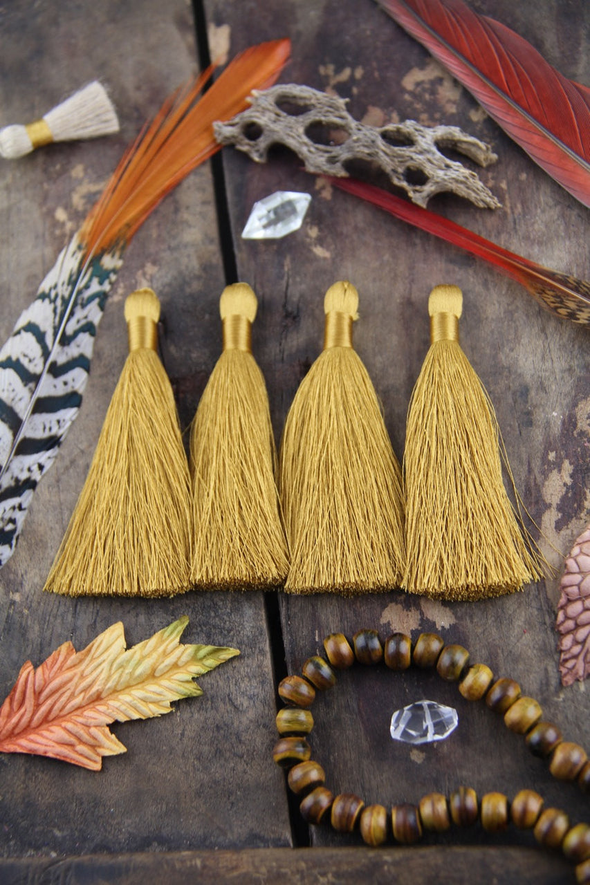 "Oak Buff, 3.5"" Silky Luxe Tassels, 2 pieces - ShopWomanShopsWorld.com. Bone Beads, Tassels, Pom Poms, African Beads."