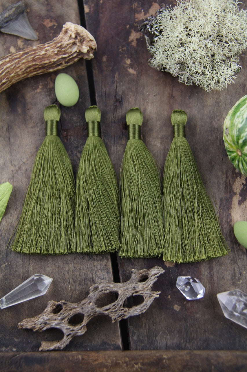 "Mossy Green 3.5"" Silky Luxe Tassels, 2 pieces - ShopWomanShopsWorld.com. Bone Beads, Tassels, Pom Poms, African Beads."