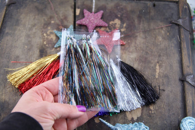 "Various Tinsel: 4"" Metallic/Sparkly Tassels, 4 pieces - ShopWomanShopsWorld.com. Bone Beads, Tassels, Pom Poms, African Beads."