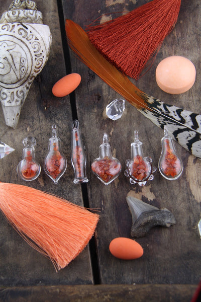 Carnelian Magic: Tiny Glass Bottle Pendant with Carnelian Chips, Charm with Gemstone Chips, Bohemian Jewelry Making Supply, Gift for Her - ShopWomanShopsWorld.com. Bone Beads, Tassels, Pom Poms, African Beads.