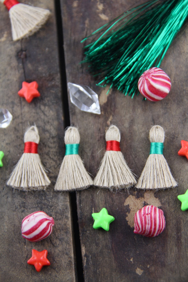 "Christmas Mini Jute Tassels, 1.25"" with Red & Green Binding, 4 pieces - ShopWomanShopsWorld.com. Bone Beads, Tassels, Pom Poms, African Beads."