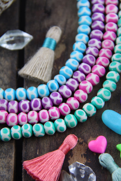 Infinity Circles Pastel Bone Beads, 6x8mm, 31 pieces - ShopWomanShopsWorld.com. Bone Beads, Tassels, Pom Poms, African Beads.
