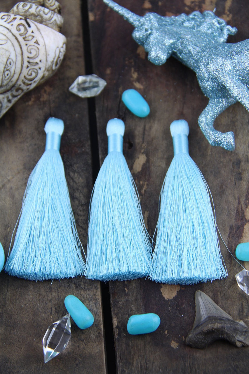 Limpet Shell Pastel Blue Silky Jewelry Tassels, 2 Pieces - ShopWomanShopsWorld.com. Bone Beads, Tassels, Pom Poms, African Beads.