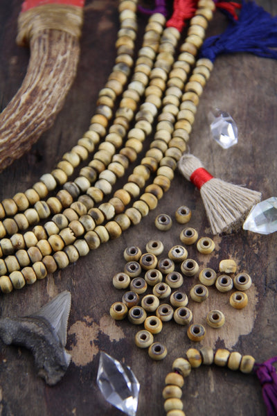 Drift: Balsa Wood Beads, 7x5mm, 43 pieces - ShopWomanShopsWorld.com. Bone Beads, Tassels, Pom Poms, African Beads.