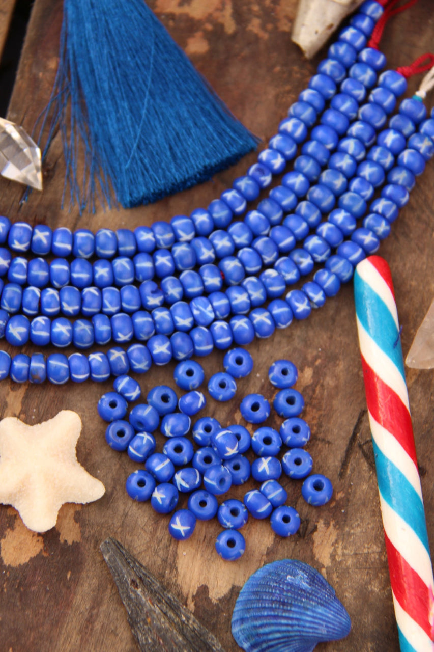 Cobalt X: Hand Carved Bone Beads, 6x8mm, 36 pieces - ShopWomanShopsWorld.com. Bone Beads, Tassels, Pom Poms, African Beads.
