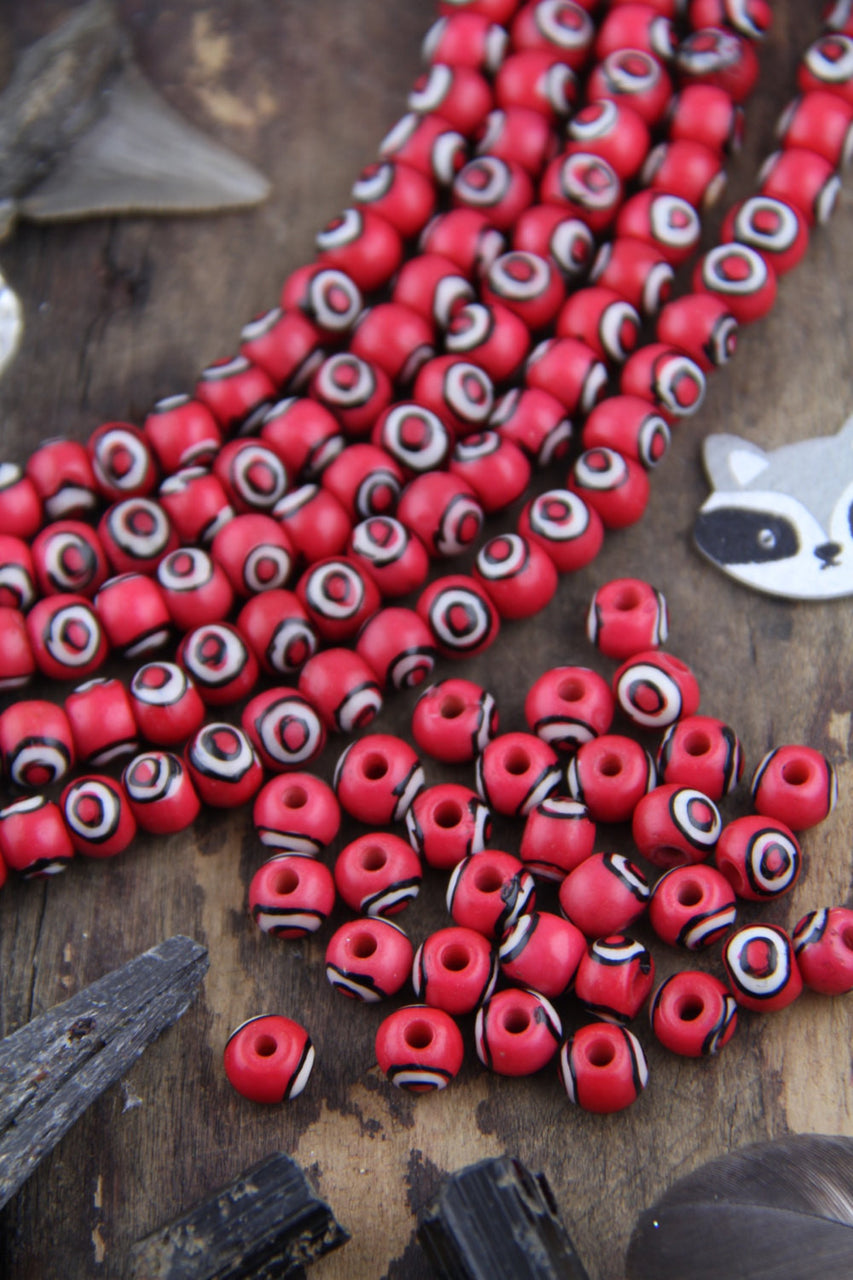 Red Bullseye Bone Beads, 6x8mm, 30 pieces - ShopWomanShopsWorld.com. Bone Beads, Tassels, Pom Poms, African Beads.