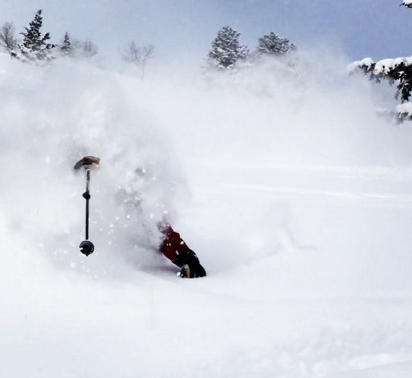 ski patrol skiing deep powder