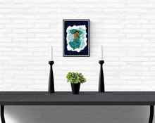 Load image into Gallery viewer, Framed artwork hanging on a white brick wall in a home