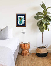 Load image into Gallery viewer, Framed wall art print displayed on a bedroom wall next to a bed, a lamp and a plant