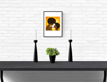 Load image into Gallery viewer, An art print of a black mother and daughter withs afros smiling at each other mounted on a white brick wall