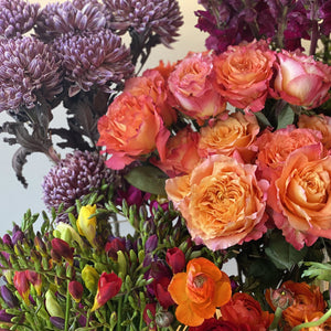 The mix of freesias, roses, chrysanthemums, and anemones which line the flower stand here at Red Fragrance in August.