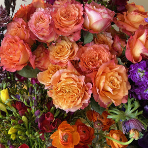 Delicate roses, freesias and anemones.