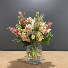Load image into Gallery viewer, When our talented florists interlace multi coloured daffodils, peach stock and Australian natives, this is the result. Beauty!
