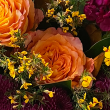 Load image into Gallery viewer, Just like the great Australian sunset, this medium sized (pictured) bunch will delight the senses. Centred around our vibrant native Australian flora, soft roses punctuate the classic sunset colour palette. Our florists pick only the best market flowers and at times, some of these flowers may be substituted to ensure you receive a premium product every time.