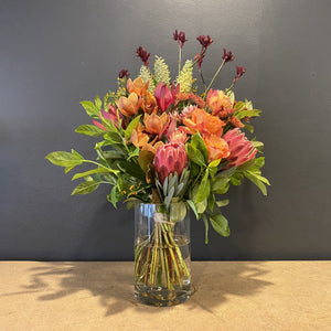 Get yourself a quirky bunch of orange and pink beauties which will delight for days. Our florists design stylistic pieces which are equal only to their </span><span>high quality. The vase is not included and from time to time some flowers may be replaced with fresher, longer lasting, but equally beautiful blooms.