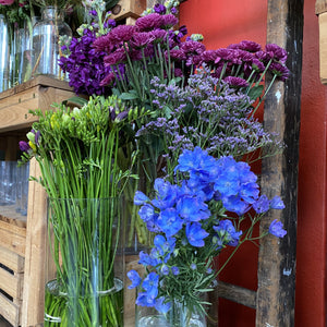 Load image into Gallery viewer, Delphinium, freesias and purple delights.