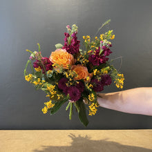 Load image into Gallery viewer, Like a tree changing colours through Autumn, the depth and breadth of colours in this bouquet playfully interact to replicate the colours of a tree losing its leaves. Our florists masterfully intertwine a combination of roses, stock and the classic Australian bacon and eggs (Medium). As with all Red Fragrance products some elements of the bouquet may need to be replaced by an equally exquisite bloom.