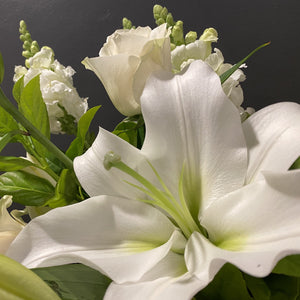 Fully blossomed Lily providing a dramatic and eye catching performance.  Lily's are a staple on our flower stand, they are also beautiful in pink.