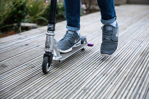 Riding a Scooter on Decking
