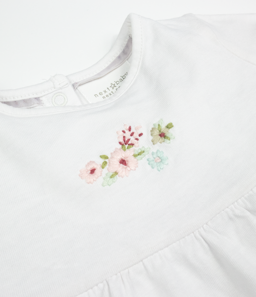 Embroidered skirted top