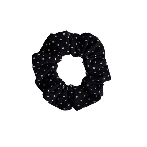 small white polka dots on black scrunchie
