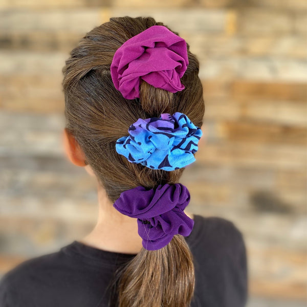 magenta ice scrunchie, aurora ombre scrunchie, and dark purple ice scrunchie in hair. Pipevine Designs