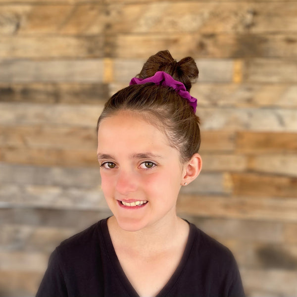 magenta ice scrunchie on hair bun Pipevine Designs
